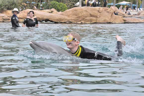Brian swimming with the dolphins